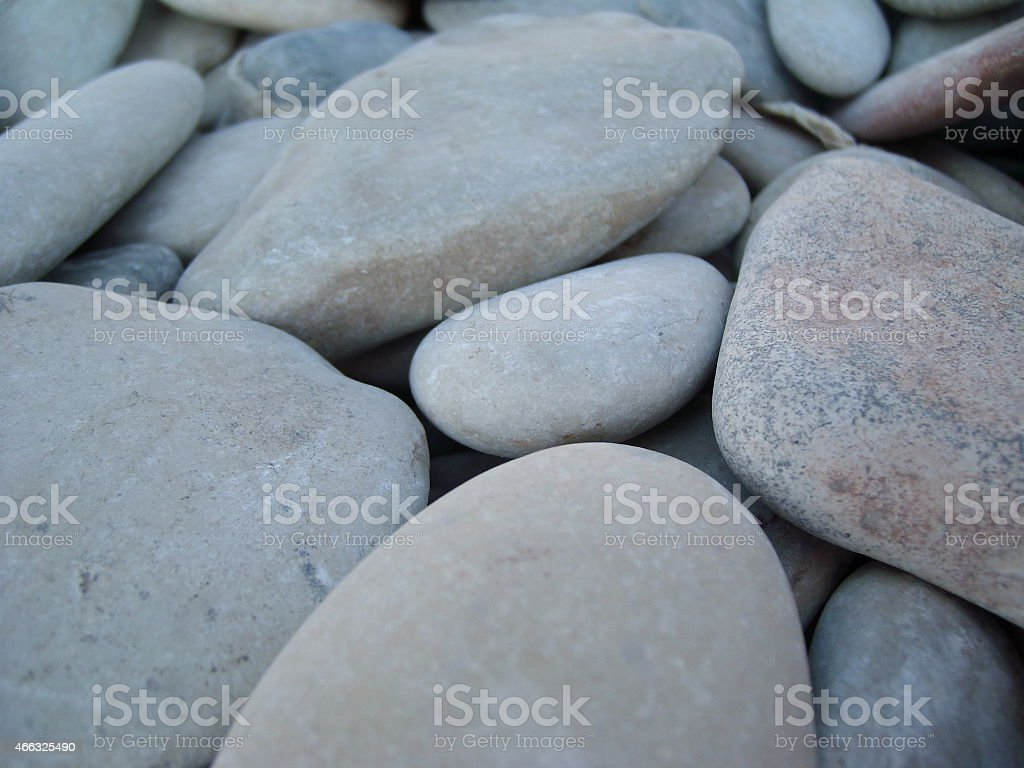 Stones pebbles on the beach. Figures from the stones. stock photo