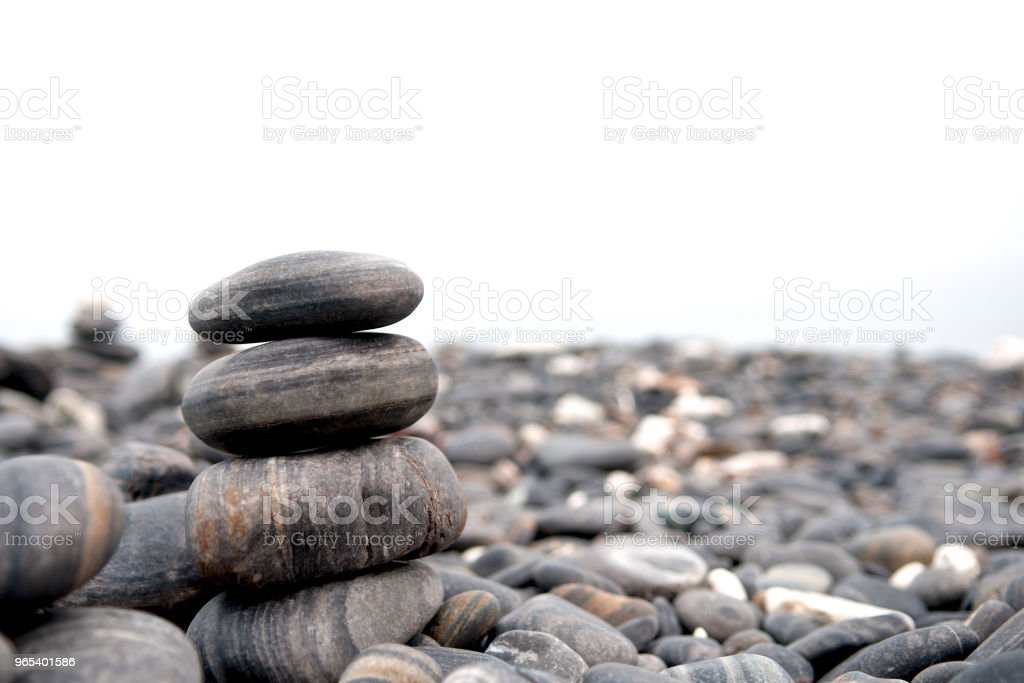 Stones stack isolated on white background. Seashore and beach. Close up. zbiór zdjęć royalty-free