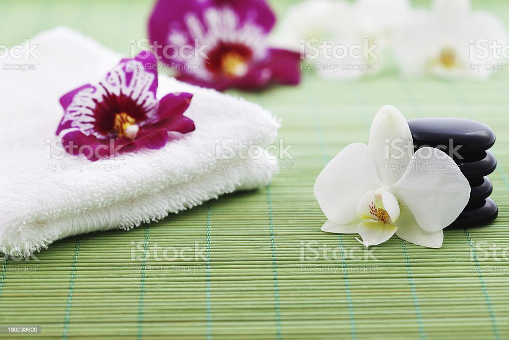Stones, Towel and Orchids Wellness Concept royalty-free stock photo