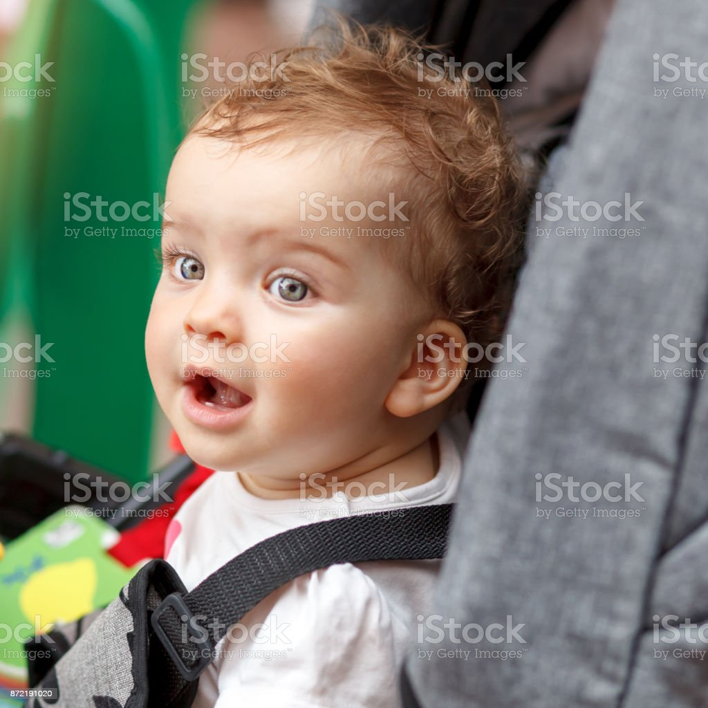 Аstonished cute little baby stock photo