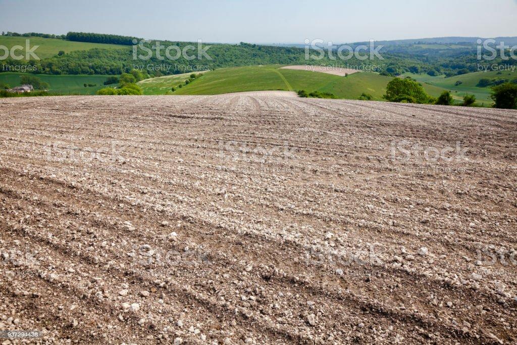 Stony barren soil plowed field Southern England UK stock photo