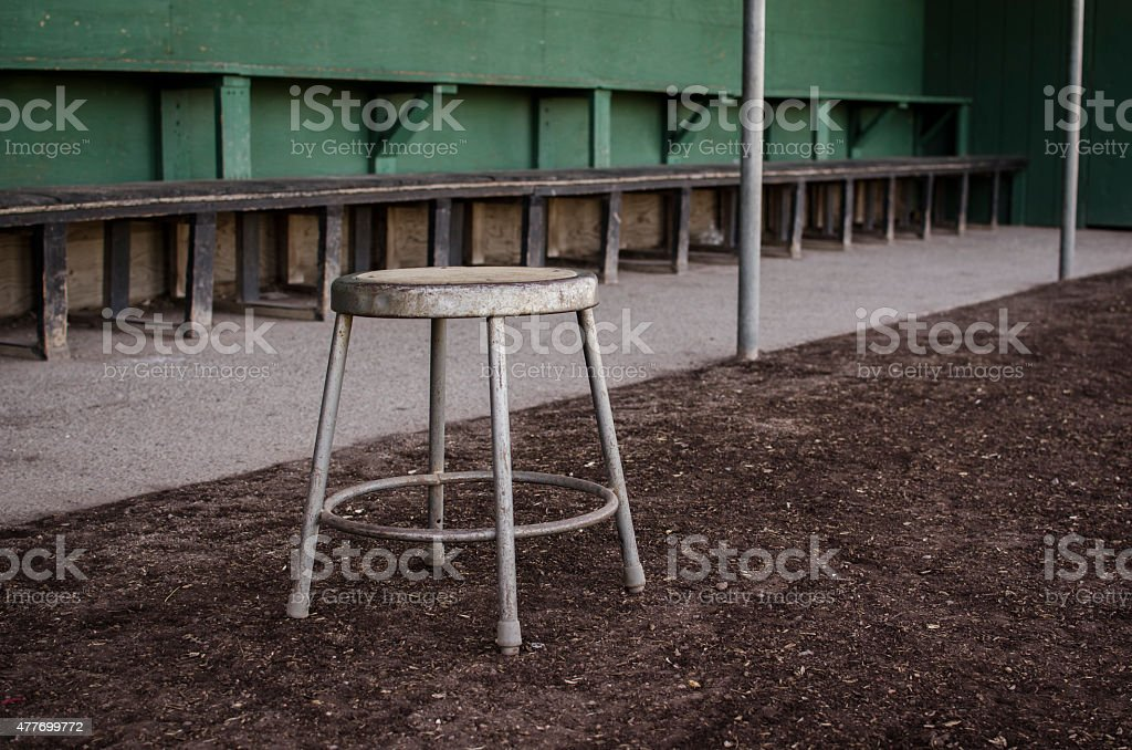 Stool in Front of High School Baseball Dugout stock photo