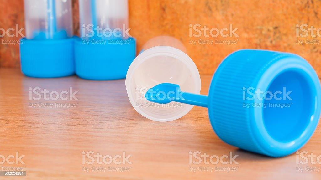 Stool sample jars with transport medium stock photo