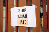 istock Stop Asian Hate sign was attached on the house fence 1303459965