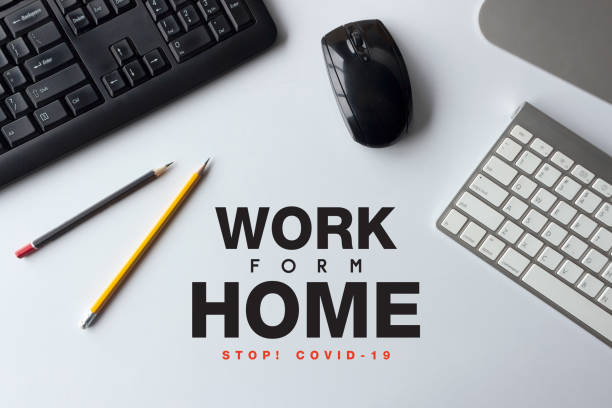stop covid-19 concept. work from home. top view of office desk workspace with pen and keyboard on white table background – zdjęcie