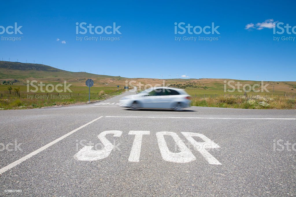 stop crossroads fast car stock photo