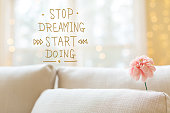 Stop Dreaming Start Doing message with flower in interior room s