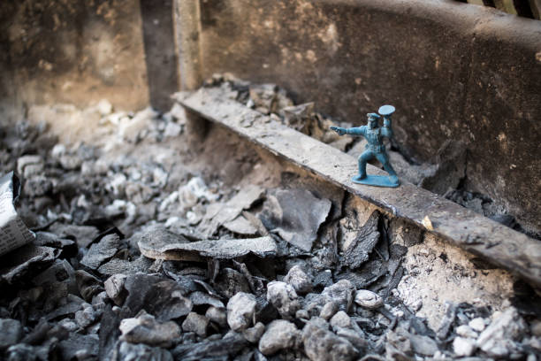 Stop Guard Toy Soldier In Fireplace Ashes stock photo
