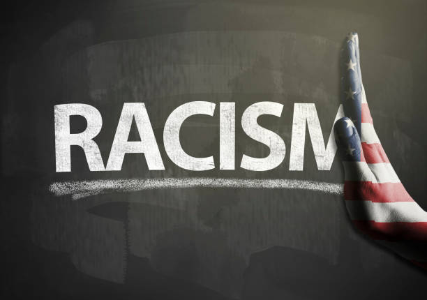 Stop hands sign with USA flag and RACISM / Flag blackboard concept (Click for more) stock photo