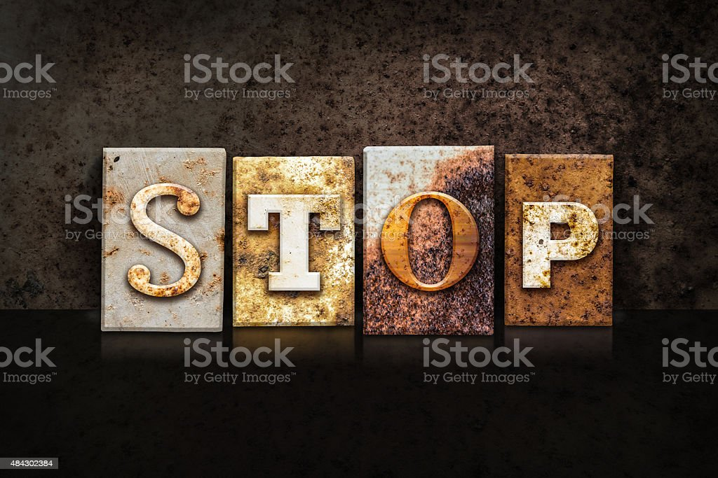Stop Letterpress Concept on Dark Background stock photo