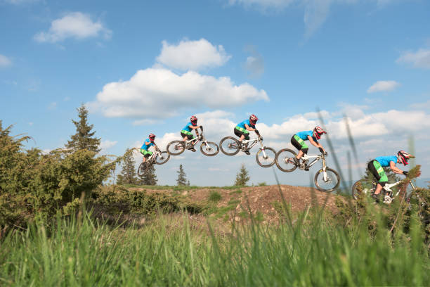 Stop Motion Photography Of Man Jumping In Midair With Mtb Stock Photo