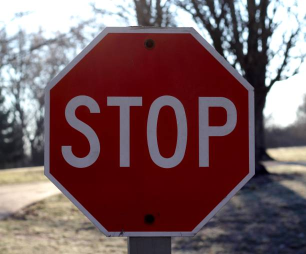 Stop A close view of the stop sign. stop single word stock pictures, royalty-free photos & images
