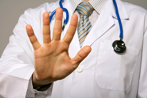 Stop!!! Doctor showing his palm. rejection stock pictures, royalty-free photos & images