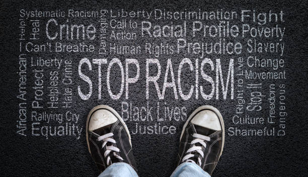Stop Racism Word Cloud on Asphalt Concept of Fighting Discrimination stock photo