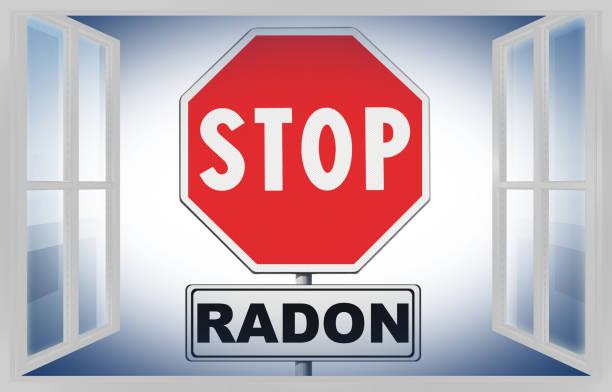radon - concept afbeelding met verkeersbord op witte achtergrond gezien door een venster stoppen - radon test stockfoto's en -beelden
