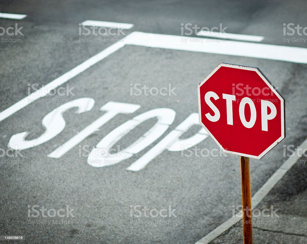 Stop Road Signal With White Sign Painted On Asphalt royalty-free stock photo