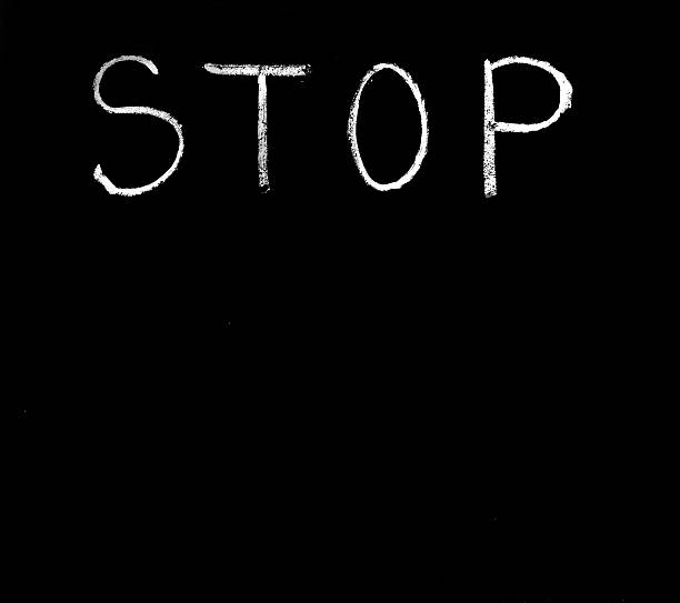 Stop sighn. Single word ,,STOP,,written with chalk on a black background. stop single word stock pictures, royalty-free photos & images