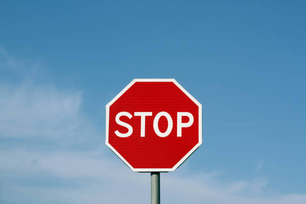 stop sign against cloudy sky. - stop sign stock pictures, royalty-free photos & images