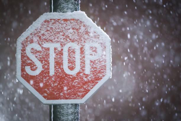 Stop sign at snowfall stock photo