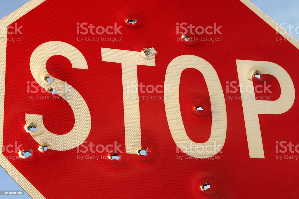 Stop Sign filled with Bullet Holes royalty-free stock photo