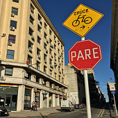 Montevideo, Uruguay - May 16, 2019: Street in downtown Montevideo with information sign indicating a bikes crossing ahead. This city, as many others in the world, has its own sharing bicycle system and is widely used by its inhabitants