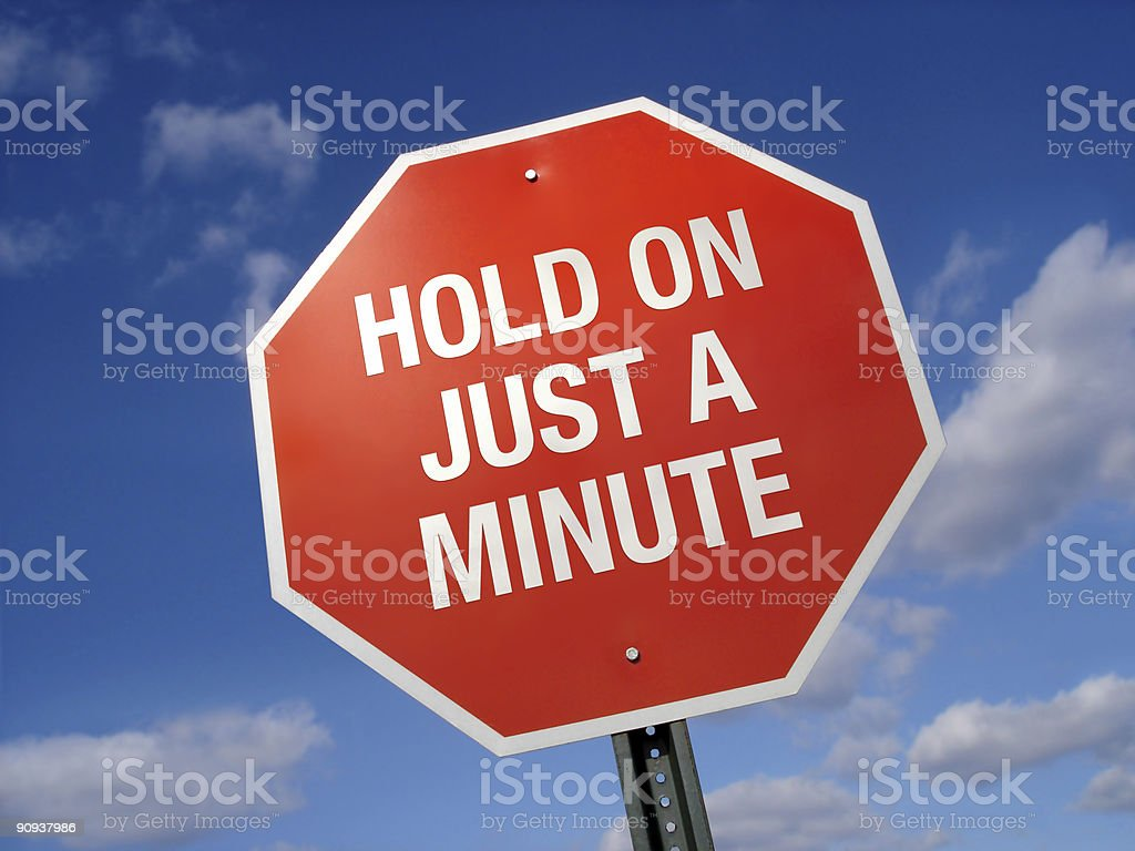 Stop Sign Hold On a Minute royalty-free stock photo