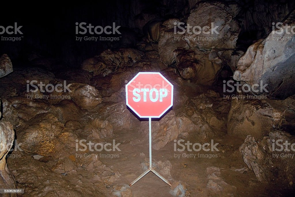 Stop sign in a cave stock photo