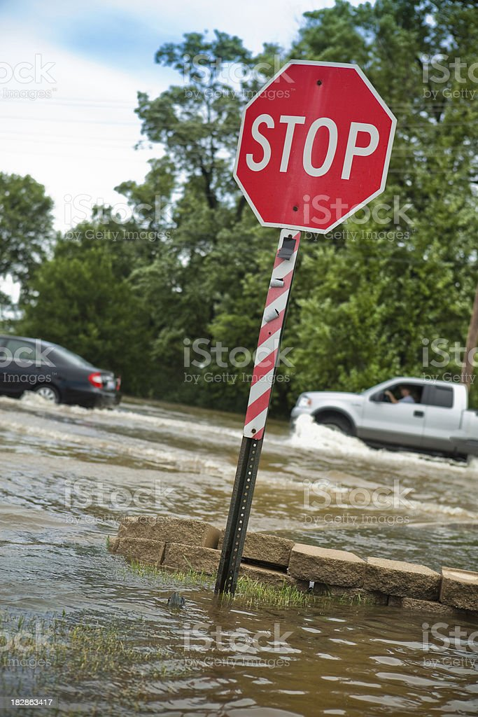 Stop Sign in a Flooded Intersection royalty-free stock photo