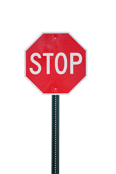 Stop Sign Isolated on White Stop sign isolated on white. Clipping path included. stop single word stock pictures, royalty-free photos & images