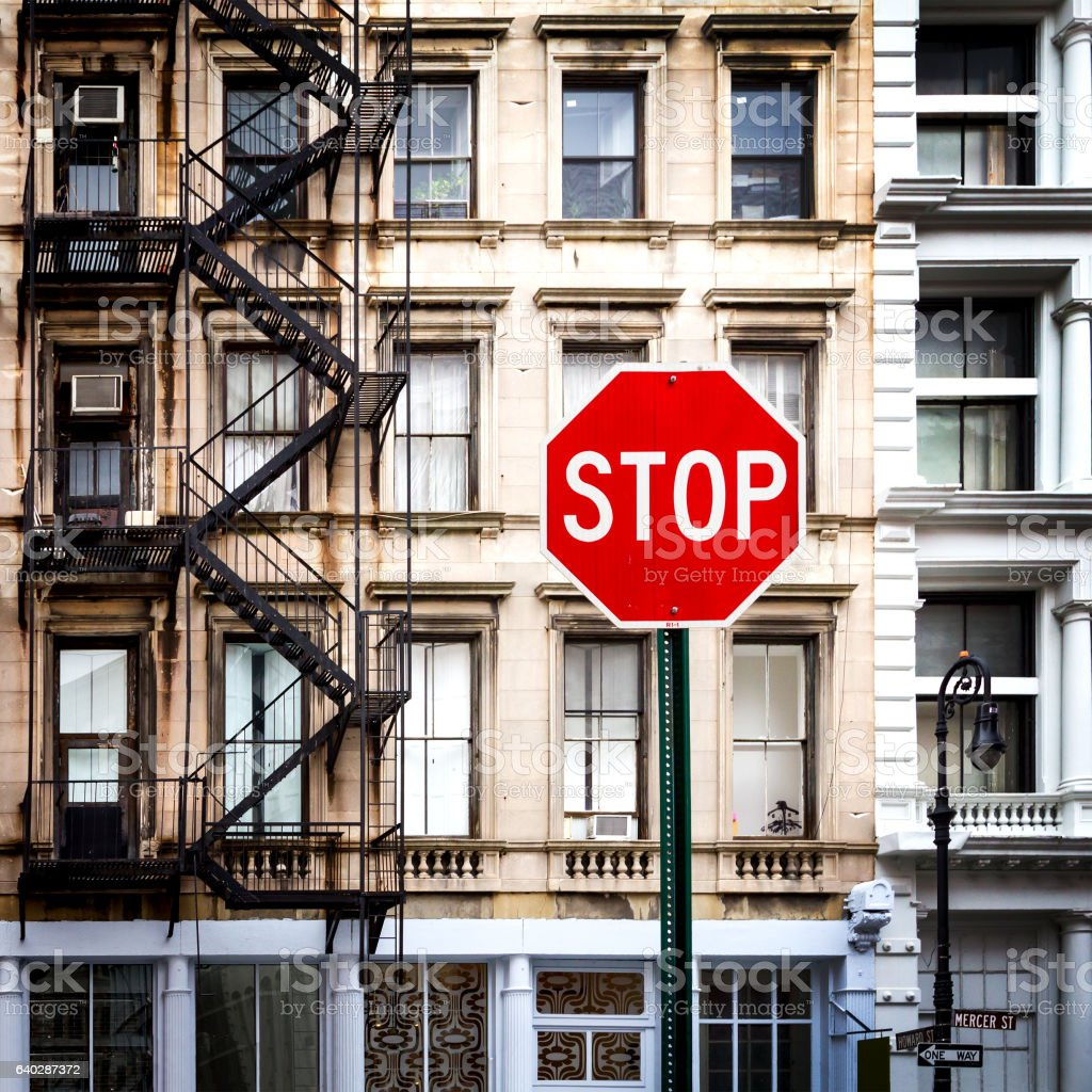 Stop Sign Near Old Buildings in New York City stock photo