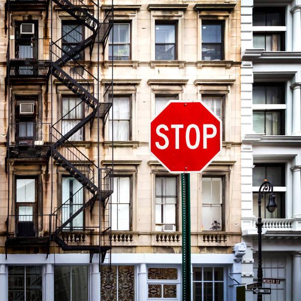 Stop Sign Near Old Buildings in New York City - foto de stock