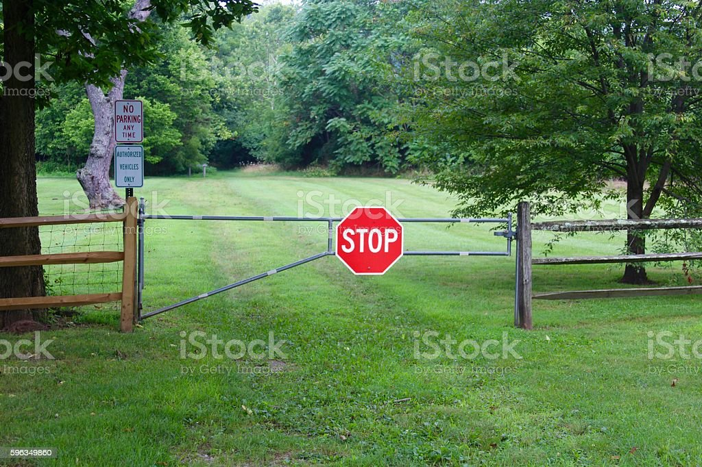 Stop Sign on a Gate royalty-free stock photo
