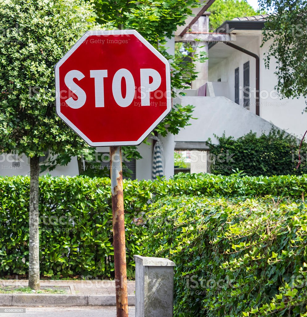 Stop sign on the road stock photo