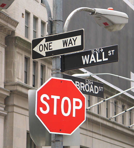 Stop Sign on Wall Street Stop sign, one way sign and Wall Street sign debt ceiling stock pictures, royalty-free photos & images