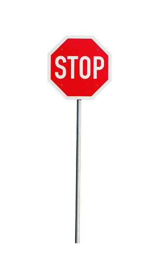 stop sign in front of blue sky