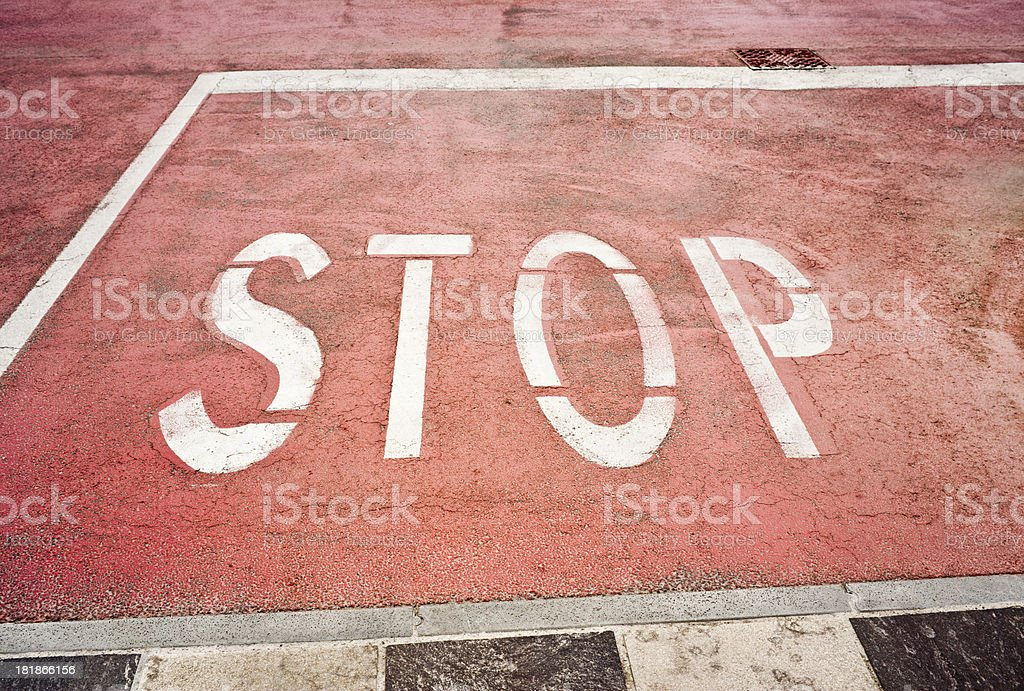 Stop Sign Painted On Pink Asphalt royalty-free stock photo