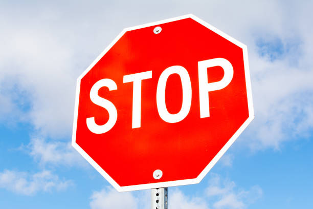 Stop sign Stop sign with blue skies and clouds in the background. Anglo American stock pictures, royalty-free photos & images