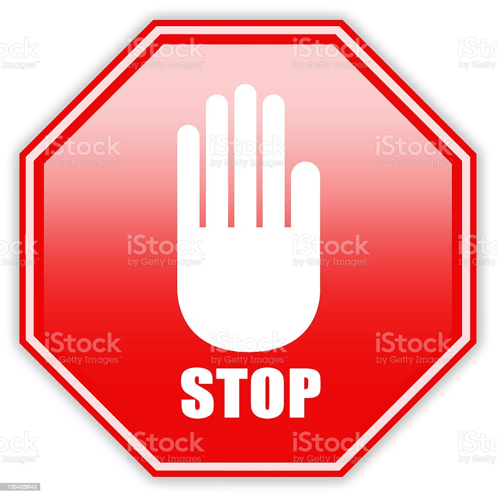 A stop sign with a white hand signaling to stop  stock photo