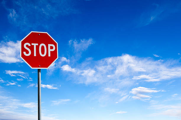 Stop Sign With Blue Sky Background and Copy Space Conceptual stop sign with blue sky background and copy space. stop single word stock pictures, royalty-free photos & images