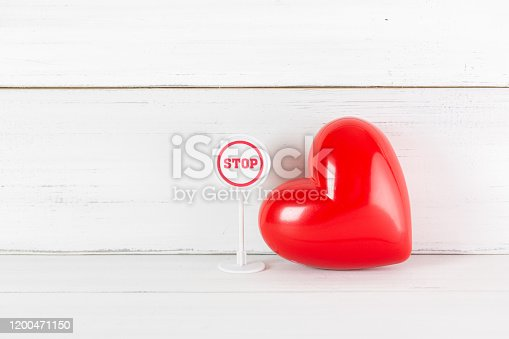 istock Stop Sign with Read Heart on white wood background. Broken Love Concept with Copy Space. 1200471150