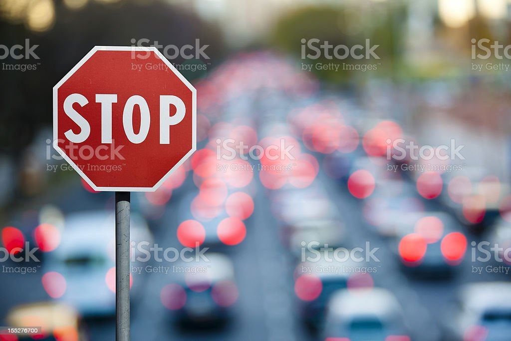 Stop sign with traffic and cars at rush hour stock photo