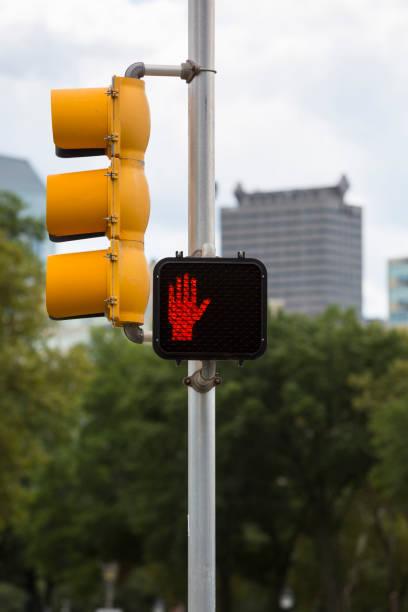 Stop signal displayed on traffic light stock photo
