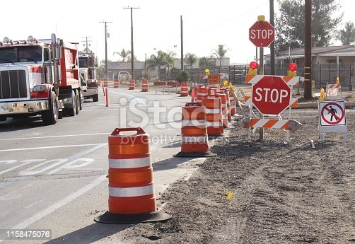 Stop Signs in Work Zone with Traffic Control in Perris California, No Walk Sign