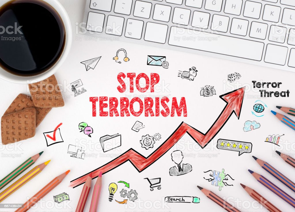 Stop terrorism Concept. Computer keyboard and cup of coffee on a white table stock photo