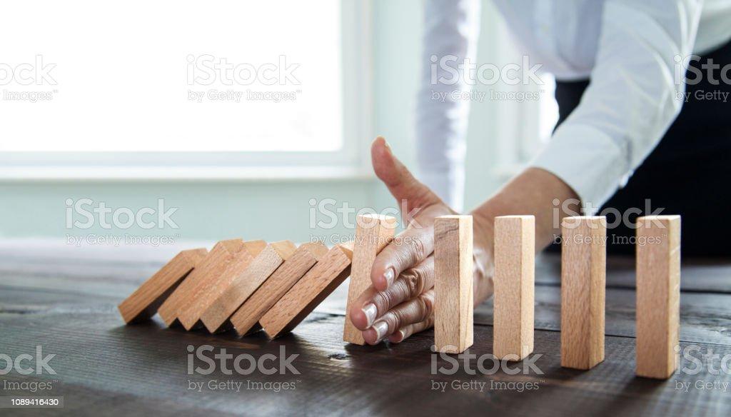 Stoppen Sie den Domino-Effekt – Foto