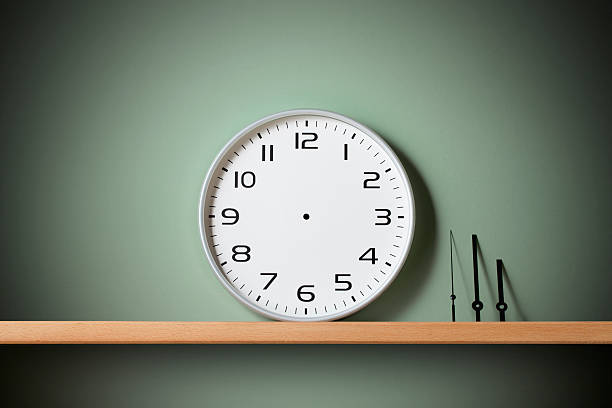 Stop time. Clock on the shelf. Blank clock face with hour, minute and second hands on the shelf. eternity stock pictures, royalty-free photos & images