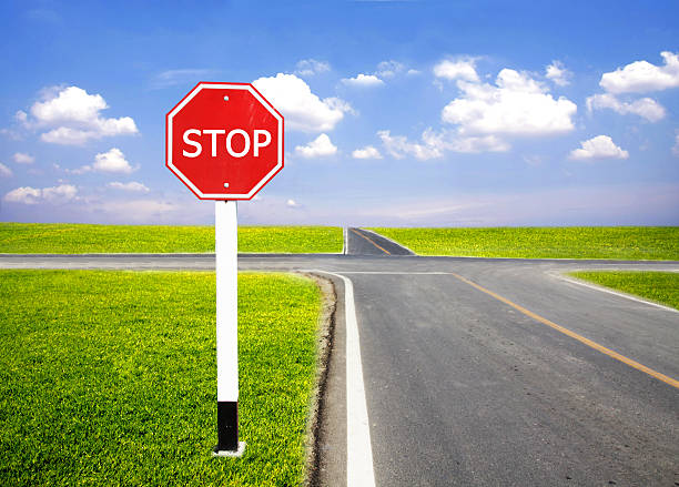 stop traffic sign pole stock photo