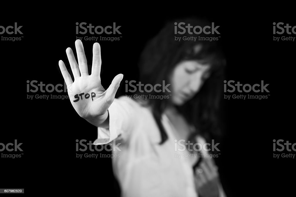 Stop violence against women. Hand saying stop stock photo