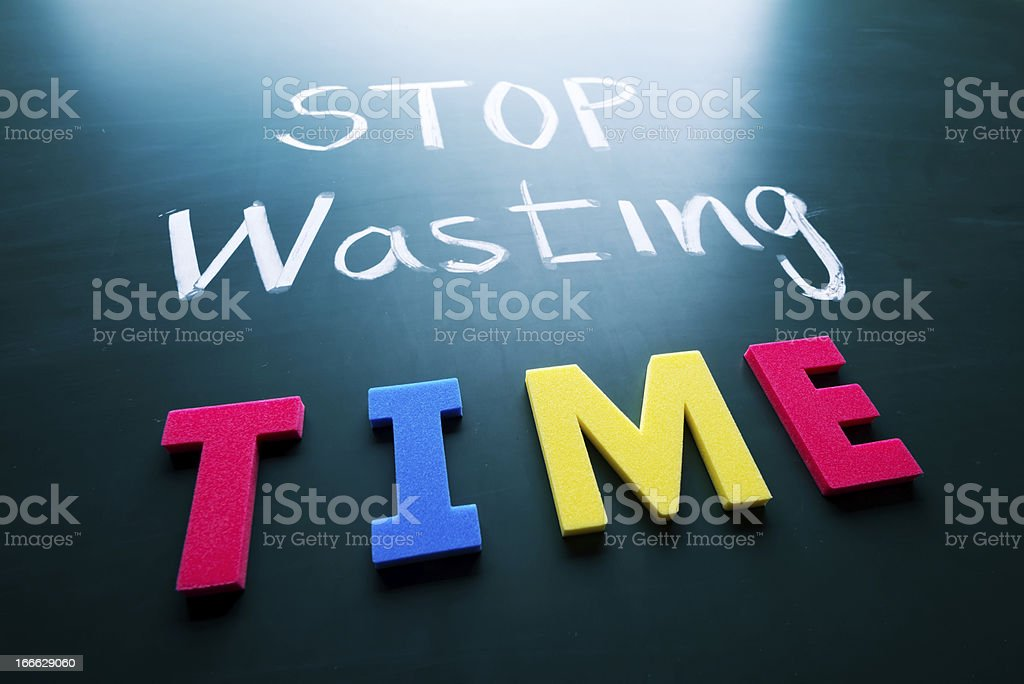 Stop wasting time concept stock photo