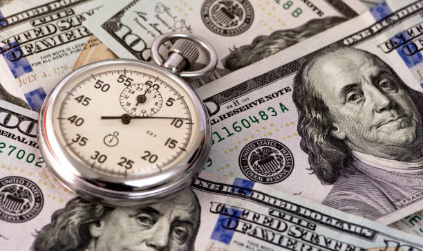 stop watch  and american dollars stock photo stock photo